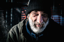 Close Up Portrait Of Old Smiling Homeless Alcoholic Man Face With White Beard And Hair Wandering On The Street Depressed Sick And Lonely On Cold Winter Day, Social Issues Documentary Concept