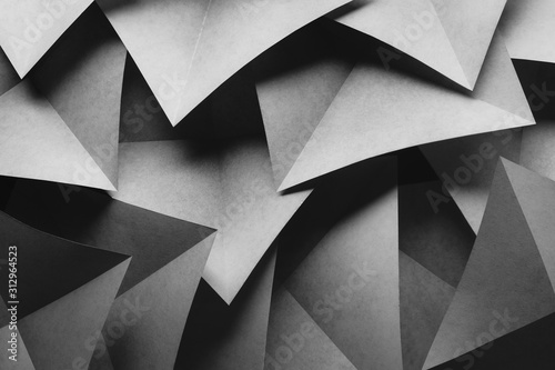 Geometric shapes made paper, dark background.