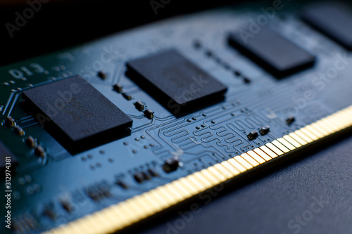 Obraz na plátně Contacts, connecting tracks and microchips of a computer RAM Random Access Memory modules close-up for electronic design