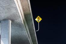 Stoplight Sign On Highway Bridge Under Night Sky