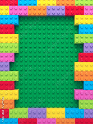 Obraz Frame of colorful toy bricks on green construction plate - fototapety do salonu