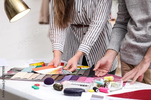 Fényképezés Fashion designers creating new clothes in studio, closeup