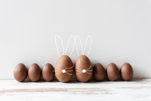 Delicious Chocolate Easter Eggs On Wooden Background.