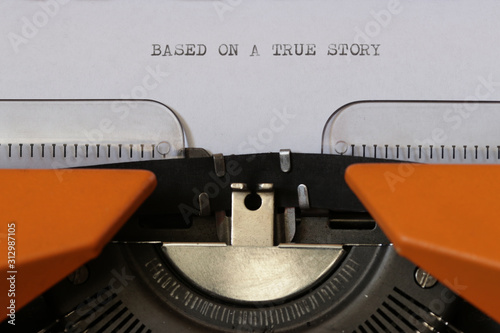 Close up footage of ˝BASED ON A TRUE STORY˝ written on a paper, on an old typewriter with capital letters Wallpaper Mural
