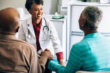 Doctor Consulting Mature Couple
