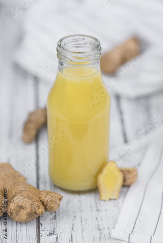 Portion of Ginger Juice as detailed close-up shot; selective focus