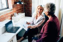 Woman Mentoring At Work