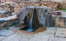 A Fountain Ruins Carved In Stone  Called The Bath Of The Princess, Ollantaytambo Archaeological Park, Peru