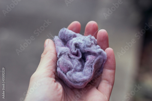 Fluff / lint on laundry after removing from clothing dryer isolated on white background Fototapet