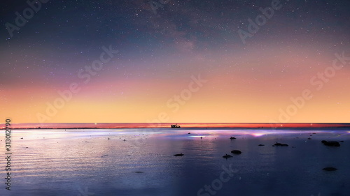 sea pink sunset blue night starry sky and light reflection  on water sky summer nature background  skyline horizon landscape