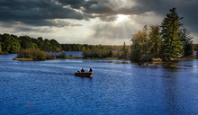 Fishermen In Fishing Boat On Lake In Michigan