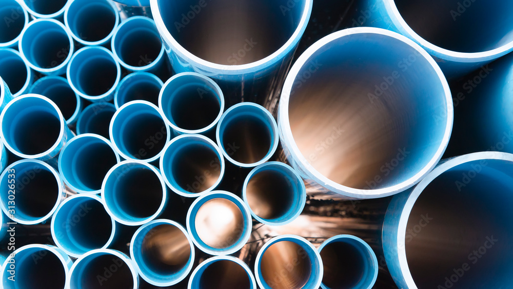 Fototapeta Blue plastic pipes used in construction site.Blue PVC water pipe in storage.Packaged blue plastic water pipes at warehouse.