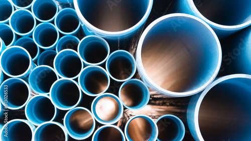 Leinwand Poster Blue plastic pipes used in construction site