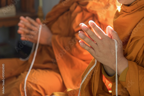 Stampa su Tela Buddhist monk praying hand in buddhism tradition ceremony.
