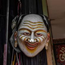 A Mask Of A Man In Buddhist Religion In Bouddhanath Stupa In Kathmandu, Nepal