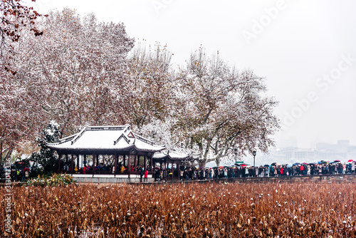 The beautiful Snow winter landscape scenery of Xihu West Lake and pavilion with garden in Hangzhou China Canvas Print