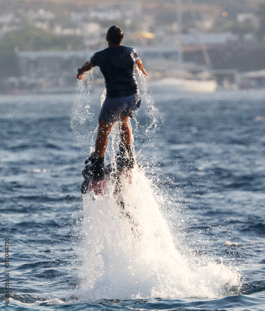 Fototapeta A man on a water attraction at sea