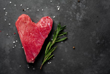 Heart Shaped Raw Beef Steak With Spices For Valentines Day On Stone Background With Copy Space For Your Text, Concept Of Cooking Dinner For Valentines Day
