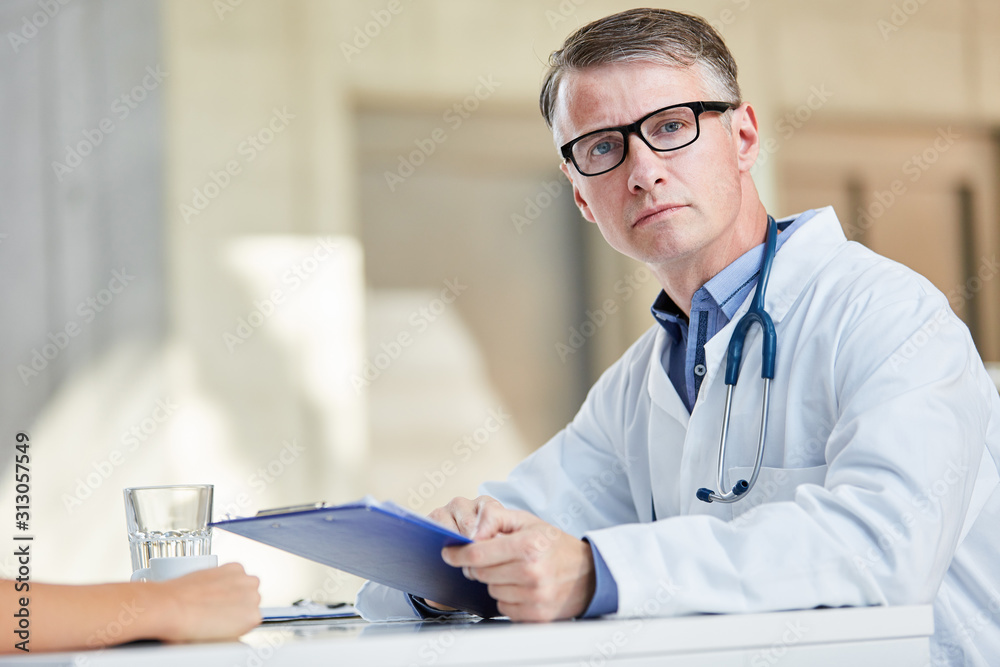 Fototapeta Doctor as chief physician or clinic director with authority