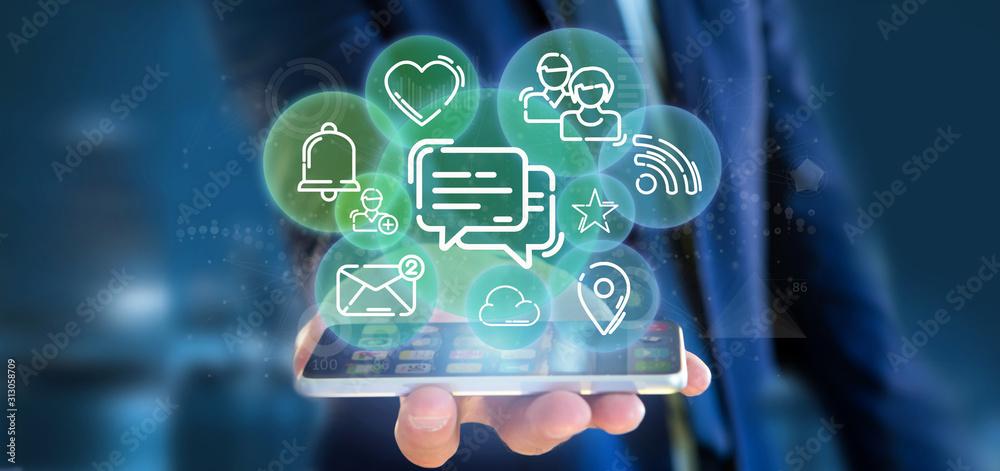 Fototapeta Businessman holding a cloud of social media network icon
