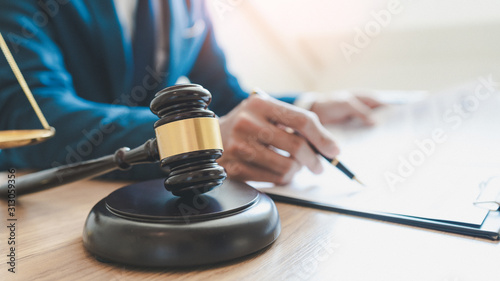 Obraz lawyer judge reading documents at desk in courtroom. - fototapety do salonu