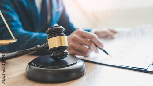 Fototapeta lawyer judge reading documents at desk in courtroom. obraz