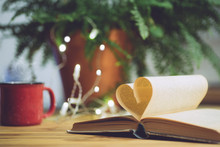 Love Reading Or Saint Valentine's Day Background. Open Book With A Heart Shape Page. Knowledge, Education Or Love Concept