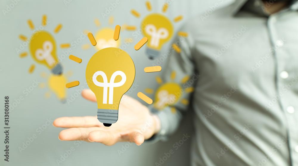 Fototapeta Bright idea in hand concept design art.