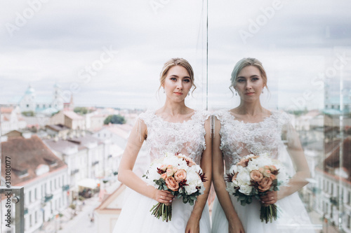 Photo Wedding fashion blondie caucasian girl in beautiful dress outdoors in old city background