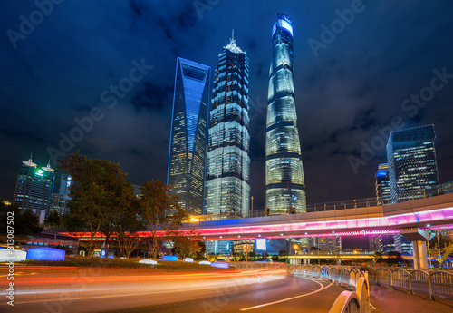 Photo under the pedestrian bridge of shanghai cityscape at night, China