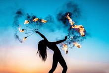 Fire Show At Sunset. Silhouett...