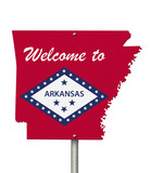 Welcome to the state of Arkansas road sign in the shape of the state map with the flag
