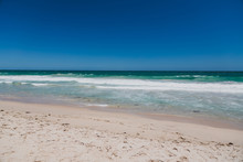 View Of Scarborough Beach, One Of The Most Popular Beaches Near Perth On The Indian Ocean, With Intense Turquoise Water And Ships In The Distance