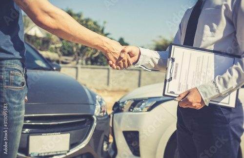 Customers shake hand with car insurance agents to enter into friendly terms and conditions, Car crash on the road concept Canvas Print