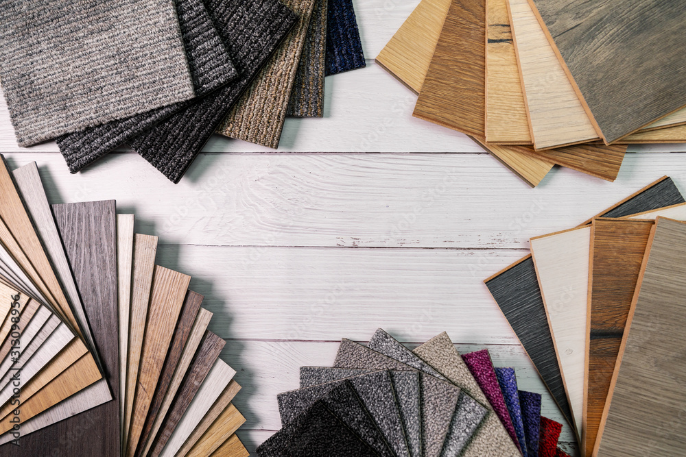 Fototapeta flooring and furniture materials - floor carpet and wooden laminate samples with copy space