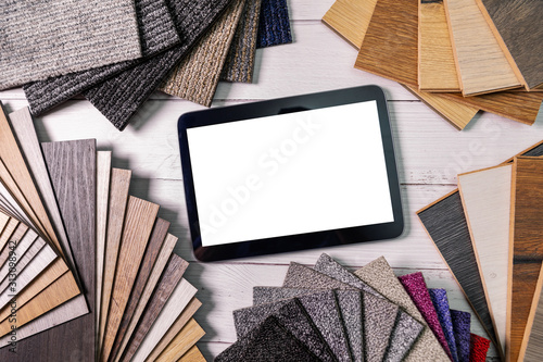 Obraz flooring and furniture materials - floor carpet and wooden laminate samples with blank digital tablet - fototapety do salonu