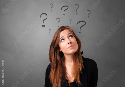 Obraz Person with question marks around face - fototapety do salonu