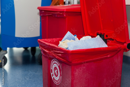 Photo Biological risk waste disposed of in the red trash bag at a operating room in a