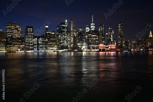 Fototapety, obrazy: New york skyline from brooklyn at night with water reflection