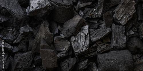 black coal background. charcoal woody black.  lot of wood - 313117549