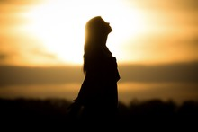 Youth Woman Soul At Orange Sun...