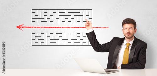 Cuadros en Lienzo Businessman presenting a maze on a wall