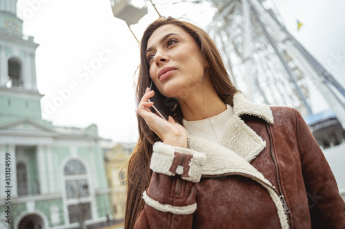 Attentive young female person listening to her interlocutor Wallpaper Mural