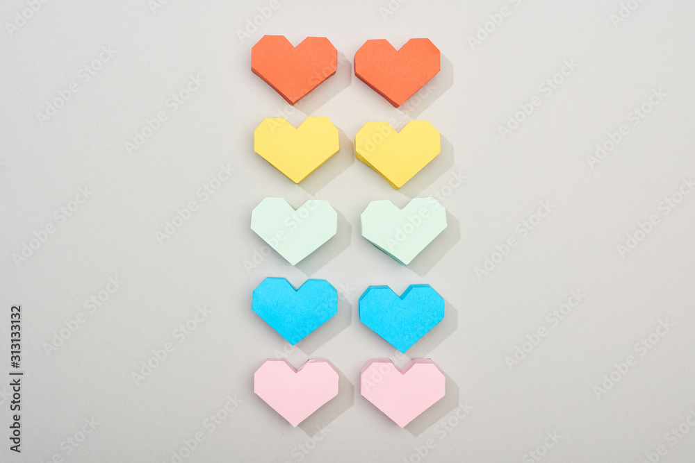 Fototapeta Top view of decorative paper hearts on grey background