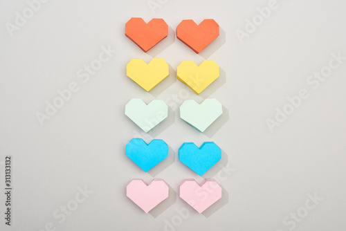 Obraz Top view of decorative paper hearts on grey background - fototapety do salonu