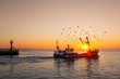 canvas print picture - Fishing boat in front of the old wooden pier of Nieuwpoort (Belgium) at sunset
