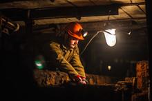 A Tired Miner In A Coal Mine L...
