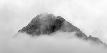 Panoramic Black And White View Of Cloud Covered Desert Mountain Peak At Red Rock Canyon National Conservation Area.  A Popular Natural Area 20 Miles From The Las Vegas Strip In Southern Nevada.