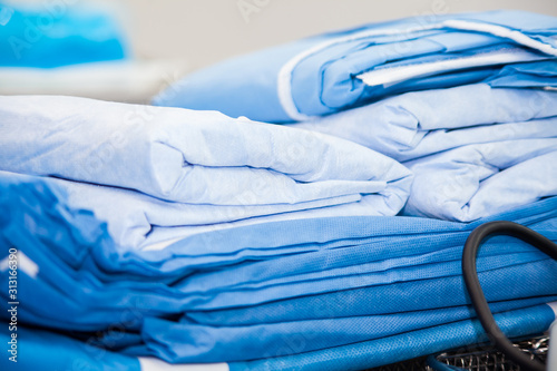Sterile material and clothing ready for a surgical procedure at an operation roo Canvas Print