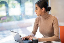 Young Woman Using Laptop In A ...
